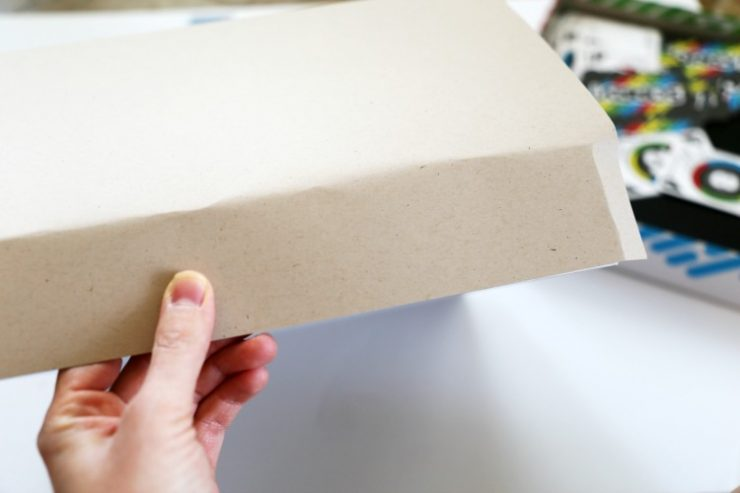 Covering a Board Game with Brown Paper